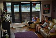 9 May 2020; Borris-Kilcotton hurler Brian Stapleton, Laois, and Johnstownbridge camogie player Róisín Stapleton, Kildare, watch TV in their living-room overlooking MW Hire O'Moore Park on the evening of the Leinster GAA Hurling Senior Championship Round 1 match between Laois and Galway at MW Hire O'Moore Park in Portlaoise, Laois. This weekend, May 9 and 10, was due to be the first weekend of games in Ireland of the GAA All-Ireland Senior Championship, beginning with provincial matches, which have been postponed following directives from the Irish Government and the Department of Health in an effort to contain the spread of the Coronavirus (COVID-19). The GAA have stated that no inter-county games will take place before October 2020. Photo by Harry Murphy/Sportsfile