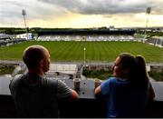 9 May 2020; Borris-Kilcotton hurler Brian Stapleton, Laois, and Johnstownbridge camogie player Róisín Stapleton, Kildare, have a cup of tea on their balcony overlooking MW Hire O'Moore Park on the evening of the Leinster GAA Hurling Senior Championship Round 1 match between Laois and Galway at MW Hire O'Moore Park in Portlaoise, Laois. This weekend, May 9 and 10, was due to be the first weekend of games in Ireland of the GAA All-Ireland Senior Championship, beginning with provincial matches, which have been postponed following directives from the Irish Government and the Department of Health in an effort to contain the spread of the Coronavirus (COVID-19). The GAA have stated that no inter-county games will take place before October 2020. Photo by Harry Murphy/Sportsfile