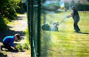 15 May 2020; Matthew Mc Glade, age 6, from Grosvenor Square, prepares the tennis lawns, under the supervision of his father Marc, a committee memeber, at Stratford Lawn Tennis Club in Rathmines, Dublin, as it prepares to re-open as one of the first sports allowed to resume having followed previous directives from the Irish Government on suspending all tennis activity in an effort to contain the spread of the Coronavirus (COVID-19). Tennis clubs in the Republic of Ireland can resume activity from May 18th under the Irish government's Roadmap for Reopening of Society and Business once they follow the protocol published by the Tennis Ireland. The protocol sets out safe measures for tennis to return in a phased manner. Photo by Stephen McCarthy/Sportsfile