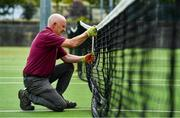15 May 2020; Malahide Lawn Tennis and Croquet Club groundsman Eamonn O'Donnell prepares the nets on the main courts as it prepares to re-open as one of the first sports allowed to resume having followed previous directives from the Irish Government on suspending all tennis activity in an effort to contain the spread of the Coronavirus (COVID-19). Tennis clubs in the Republic of Ireland can resume activity from May 18th under the Irish government's Roadmap for Reopening of Society and Business once they follow the protocol published by Tennis Ireland. The protocol sets out safe measures for tennis to return in a phased manner. Photo by Brendan Moran/Sportsfile