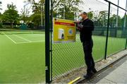 15 May 2020; Paul Foley of Digital Print and Image prepares a hand sanitising station at Malahide Lawn Tennis and Croquet Club in Dublin as it prepares to re-open as one of the first sports allowed to resume having followed previous directives from the Irish Government on suspending all tennis activity in an effort to contain the spread of the Coronavirus (COVID-19). Tennis clubs in the Republic of Ireland can resume activity from May 18th under the Irish government's Roadmap for Reopening of Society and Business once they follow the protocol published by Tennis Ireland. The protocol sets out safe measures for tennis to return in a phased manner. Photo by Brendan Moran/Sportsfile