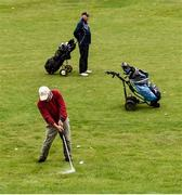 18 May 2020; Club member Brendan Foy, from Clontarf, plays a shot on the 13th fairway, watched by Paul McMahon from Raheny during a round of golf at Clontarf Golf Club in Dublin as it resumes having previously suspended all activity following directives from the Irish Government in an effort to contain the spread of the Coronavirus (COVID-19). Golf clubs in the Republic of Ireland resumed activity on May 18th under the Irish government's Roadmap for Reopening of Society and Business following strict protocols of social distancing and hand sanitisation among others allowing it to return in a phased manner. Photo by Sam Barnes/Sportsfile