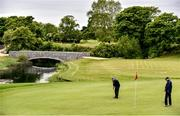 18 May 2020; Club member Aidan Foy, from Clontarf, putts on the 12th watched by Paul McMahon from Raheny during a round of golf at Clontarf Golf Club in Dublin as it resumes having previously suspended all activity following directives from the Irish Government in an effort to contain the spread of the Coronavirus (COVID-19). Golf clubs in the Republic of Ireland resumed activity on May 18th under the Irish government's Roadmap for Reopening of Society and Business following strict protocols of social distancing and hand sanitisation among others allowing it to return in a phased manner. Photo by Sam Barnes/Sportsfile