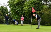 18 May 2020; Club member Ian McEntaggart, from Brookfield, Coollattin, putts on the first green, watched by Siobhan McEntaggart and Tom Ryan during a round of golf at Coollattin Golf Club in Wicklow as it resumes having previously suspended all activity following directives from the Irish Government in an effort to contain the spread of the Coronavirus (COVID-19). Golf clubs in the Republic of Ireland resumed activity on May 18th under the Irish government's Roadmap for Reopening of Society and Business following strict protocols of social distancing and hand sanitisation among others allowing it to return in a phased manner. Photo by Matt Browne/Sportsfile