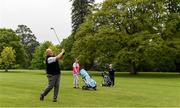 18 May 2020; Club member Ian McEntaggart, from Brookfield, Coollattin, watches his second shot from the first fairway with Siobhan McEntaggart and Tom Ryan during a round of golf at Coollattin Golf Club in Wicklow as it resumes having previously suspended all activity following directives from the Irish Government in an effort to contain the spread of the Coronavirus (COVID-19). Golf clubs in the Republic of Ireland resumed activity on May 18th under the Irish government's Roadmap for Reopening of Society and Business following strict protocols of social distancing and hand sanitisation among others allowing it to return in a phased manner. Photo by Matt Browne/Sportsfile