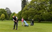 18 May 2020; Club member Ian McEntaggart, from Brookfield, Coollattin, plays his second shot from the first fairway, watched by Siobhan McEntaggart and Tom Ryan during a round of golf at Coollattin Golf Club in Wicklow as it resumes having previously suspended all activity following directives from the Irish Government in an effort to contain the spread of the Coronavirus (COVID-19). Golf clubs in the Republic of Ireland resumed activity on May 18th under the Irish government's Roadmap for Reopening of Society and Business following strict protocols of social distancing and hand sanitisation among others allowing it to return in a phased manner. Photo by Matt Browne/Sportsfile