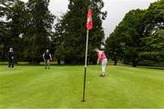 18 May 2020; Club member Siobhan McEntaggart, from Brookfield, Coollattin, watches her putt on the first green with Tom Ryan, left, and Ian McEntaggart during a round of golf at Coollattin Golf Club in Wicklow as it resumes having previously suspended all activity following directives from the Irish Government in an effort to contain the spread of the Coronavirus (COVID-19). Golf clubs in the Republic of Ireland resumed activity on May 18th under the Irish government's Roadmap for Reopening of Society and Business following strict protocols of social distancing and hand sanitisation among others allowing it to return in a phased manner. Photo by Matt Browne/Sportsfile