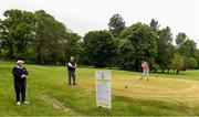 18 May 2020; Club member Siobhan McEntaggart, from Brookfield, Coollattin, makes a tee shot, watched by Ian McEntaggart and Tom Ryan during a round of golf at Coollattin Golf Club in Wicklow as it resumes having previously suspended all activity following directives from the Irish Government in an effort to contain the spread of the Coronavirus (COVID-19). Golf clubs in the Republic of Ireland resumed activity on May 18th under the Irish government's Roadmap for Reopening of Society and Business following strict protocols of social distancing and hand sanitisation among others allowing it to return in a phased manner. Photo by Matt Browne/Sportsfile