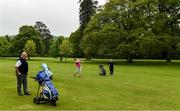 18 May 2020; Club member Siobhan McEntaggart, from Brookfield, Coollattin, plays her second shot from the first fairway, watched by Ian McEntaggart and Tom Ryan during a round of golf at Coollattin Golf Club in Wicklow as it resumes having previously suspended all activity following directives from the Irish Government in an effort to contain the spread of the Coronavirus (COVID-19). Golf clubs in the Republic of Ireland resumed activity on May 18th under the Irish government's Roadmap for Reopening of Society and Business following strict protocols of social distancing and hand sanitisation among others allowing it to return in a phased manner. Photo by Matt Browne/Sportsfile