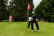 18 May 2020; Club member Tom Ryan from Croneyhorn, Wicklow, takes his ball from the hole on the first green during a round of golf at Coollattin Golf Club in Wicklow as it resumes having previously suspended all activity following directives from the Irish Government in an effort to contain the spread of the Coronavirus (COVID-19). Golf clubs in the Republic of Ireland resumed activity on May 18th under the Irish government's Roadmap for Reopening of Society and Business following strict protocols of social distancing and hand sanitisation among others allowing it to return in a phased manner. Photo by Matt Browne/Sportsfile