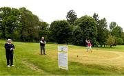 18 May 2020; Club member Siobhan McEntaggart, from Brookfield, Coollattin, tee's off, watched by Ian McEntaggart and Tom Ryan during a round of golf at Coollattin Golf Club in Wicklow as it resumes having previously suspended all activity following directives from the Irish Government in an effort to contain the spread of the Coronavirus (COVID-19). Golf clubs in the Republic of Ireland resumed activity on May 18th under the Irish government's Roadmap for Reopening of Society and Business following strict protocols of social distancing and hand sanitisation among others allowing it to return in a phased manner. Photo by Matt Browne/Sportsfile