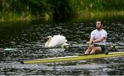 18 May 2020; Ed Meehan of Commercial Rowing Club passes a swan as he trains on the River Liffey in Dublin as it resumes having previously suspended all activity following directives from the Irish Government in an effort to contain the spread of the Coronavirus (COVID-19). Rowing clubs in the Republic of Ireland resumed activity on May 18th under the Irish government's Roadmap for Reopening of Society and Business following strict protocols of social distancing and hand sanitisation among others allowing it to return in a phased manner. Photo by Harry Murphy/Sportsfile