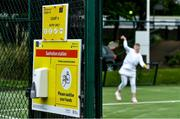 18 May 2020; A hand sanitising station is seen as club member Mary McCarthy participates in tennis at Malahide Lawn Tennis and Croquet Club in Dublin as tennis resumes having previously suspended all tennis activity following directives from the Irish Government in an effort to contain the spread of the Coronavirus (COVID-19). Tennis clubs in the Republic of Ireland resumed activity on May 18th under the Irish government's Roadmap for Reopening of Society and Business following strict protocols of social distancing, hand sanitisation and marked tennis balls among others allowing tennis to return in a phased manner. Photo by Brendan Moran/Sportsfile
