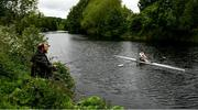 18 May 2020; Mikey Campion of Commercial Rowing Club passes fisherman Ian Murphy as he trains on the River Liffey in Dublin as it resumes having previously suspended all activity following directives from the Irish Government in an effort to contain the spread of the Coronavirus (COVID-19). Rowing clubs in the Republic of Ireland resumed activity on May 18th under the Irish government's Roadmap for Reopening of Society and Business following strict protocols of social distancing and hand sanitisation among others allowing it to return in a phased manner. Photo by Harry Murphy/Sportsfile