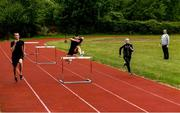 18 May 2020; Club members Jack Raftery, Alex Clarkin and Aoife Lynch participate in a training session as coach Paul Clarki looks on at Donore Harriers Athletic Club in Dublin as athletics resumes having previously suspended all activity following directives from the Irish Government in an effort to contain the spread of the Coronavirus (COVID-19). Athletics clubs in the Republic of Ireland resumed activity on May 18th under the Irish government's Roadmap for Reopening of Society and Business following strict protocols of social distancing and hand sanitisation among others allowing it to return in a phased manner. Photo by Harry Murphy/Sportsfile