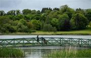 18 May 2020; A club member walks across a bridge during a round of golf at Slieve Russell Golf Club in Cavan as it resumes having previously suspended all activity following directives from the Irish Government in an effort to contain the spread of the Coronavirus (COVID-19). Golf clubs in the Republic of Ireland resumed activity on May 18th under the Irish government's Roadmap for Reopening of Society and Business following strict protocols of social distancing and hand sanitisation among others allowing it to return in a phased manner. Photo by Ramsey Cardy/Sportsfile