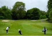 18 May 2020; Irish professional golfer Leona Maguire hits her second shot on the 3rd hole, watched by her twin sister and former professional golfer Lisa Maguire during a round of golf at Slieve Russell Golf Club in Cavan as it resumes having previously suspended all activity following directives from the Irish Government in an effort to contain the spread of the Coronavirus (COVID-19). Golf clubs in the Republic of Ireland resumed activity on May 18th under the Irish government's Roadmap for Reopening of Society and Business following strict protocols of social distancing and hand sanitisation among others allowing it to return in a phased manner. Photo by Ramsey Cardy/Sportsfile