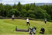 18 May 2020; Club member Jacqui Curry hits a tee shot, watched by Patricia Gilroy, centre, and Geraldine O'Neill during a round of golf at Slieve Russell Golf Club in Cavan as it resumes having previously suspended all activity following directives from the Irish Government in an effort to contain the spread of the Coronavirus (COVID-19). Golf clubs in the Republic of Ireland resumed activity on May 18th under the Irish government's Roadmap for Reopening of Society and Business following strict protocols of social distancing and hand sanitisation among others allowing it to return in a phased manner. Photo by Ramsey Cardy/Sportsfile