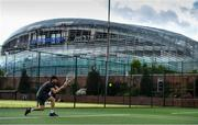 18 May 2020; Club member Donal Lynch participates in tennis at Lansdowne Lawn Tennis Club in front of Aviva Stadium in Dublin as tennis resumes having previously suspended all tennis activity following directives from the Irish Government in an effort to contain the spread of the Coronavirus (COVID-19). Tennis clubs in the Republic of Ireland resumed activity on May 18th under the Irish government's Roadmap for Reopening of Society and Business following strict protocols of social distancing, hand sanitisation and marked tennis balls among others allowing tennis to return in a phased manner. Photo by Brendan Moran/Sportsfile