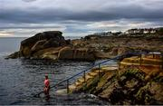 19 May 2020; Tracy Dolan from Dublin preparing to swim at the Forty Foot at Sandycove in Dublin which re-opened to the public having previously been closed off following directives from the Irish Government in an effort to contain the spread of the Coronavirus (COVID-19) pandemic. Photo by David Fitzgerald/Sportsfile