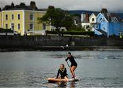 19 May 2020; Harriet Treacy, right, with her sister Pippa from Dublin, who is celebrating the end of her exams, at Sandycove in Dublin which reopened to the public having previously been closed off following directives from the Irish Government in an effort to contain the spread of the Coronavirus (COVID-19). Photo by David Fitzgerald/Sportsfile