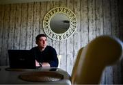 20 May 2020; Derry City manager Declan Devine works on his laptop in his kitchen at his home in Bridgend, Donegal. Photo by Stephen McCarthy/Sportsfile