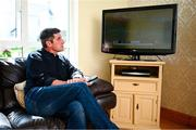 20 May 2020; Derry City manager Declan Devine watches a recording of his team on television at home in Bridgend, Donegal. Photo by Stephen McCarthy/Sportsfile