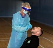 25 May 2020; Lu Kellett, Advanced Medical Services, conducts a COVID-19 swab test on Shamrock Rovers player Jack Byrne at their training facility, Roadstone Group Sports Club, in Dublin. Irish football took the first steps on the pathway to a safer return for all football when testing for COVID-19 began on Monday as part of the pilot programme and tournament for the four SSE Airtricity League clubs who will compete in Europe this year as Dundalk, Shamrock Rovers, Derry City and Bohemians prepare for a return to training. Players and staff from all four clubs were tested as the FAI continues to work on a pathway for a safer return for all Irish football in the coming months, under the supervision of Medical Director Dr Alan Byrne. Dr Byrne, a member of the Government's Return to Sport expert group, has overseen the pilot programme for the four clubs that will inform all decisions on a pathway for Irish football to return in a safe environment by the end of August. The pilot tournament, featuring the four European qualified SSE Airtricity League teams, is planned for later this summer with the clubs scheduled to resume training on June 8th. Photo by Stephen McCarthy/Sportsfile