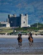 3 June 2020; Aili Leah on Lottieloveheart, left, and Leanne Breen on La Novia during a morning ride on Greencastle Beach in Greencastle, Co. Down. Horse racing is due to return behind closed doors on June 8, after racing was suspended in an effort to contain the spread of the Coronavirus (COVID-19) pandemic. Photo by Ramsey Cardy/Sportsfile