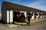 4 June 2020; Jockey Gary Halpin with an unnamed horse at the yard of horse racing trainer Kevin Prendergast in Firarstown in Kildare. Horse racing is due to return to Ireland behind closed doors on June 8, after racing was suspended in an effort to contain the spread of the Coronavirus (COVID-19) pandemic. Photo by Harry Murphy/Sportsfile