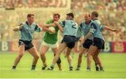 30 July 1995; Colm O'Rourke of Meath in action against Dublin players, from left, Paul Bealin, Paddy Moran, Brian Stynes and Paul Clarke during the Bank of Ireland Leinster Senior Football Championship Final match between Dublin and Meath at Croke Park in Dublin. Photo by Ray McManus/Sportsfile
