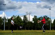 5 June 2020; Katie Sheridan, aged 10, right, and Hannah Jacobs, aged 9, both from Sandymount in Dublin practice their skills in Sean Moore Park, beside Clanna Gael Fontenoy GAA Club in Dublin, as GAA clubs prepare for the relaxation of restrictions under Phase 2 of the Irish Government's Roadmap for Reopening of Society and Business which call for strict protocols of social distancing and hand sanitisation among others measures allowing sections of society to return in a phased manner in an effort to contain the spread of the Coronavirus (COVID-19). GAA facilities are to open on Monday June 8 for the first time since March 25 but for recreational walking only and team training or matches are not permitted at this time. Photo by Sam Barnes/Sportsfile