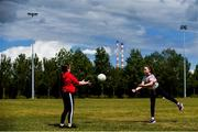 5 June 2020; Katie Sheridan, aged 10, left, and Hannah Jacobs, aged 9, both from Sandymount in Dublin practice their skills in Sean Moore Park, beside Clanna Gael Fontenoy GAA Club in Dublin, as GAA clubs prepare for the relaxation of restrictions under Phase 2 of the Irish Government's Roadmap for Reopening of Society and Business which call for strict protocols of social distancing and hand sanitisation among others measures allowing sections of society to return in a phased manner in an effort to contain the spread of the Coronavirus (COVID-19). GAA facilities are to open on Monday June 8 for the first time since March 25 but for recreational walking only and team training or matches are not permitted at this time. Photo by Sam Barnes/Sportsfile
