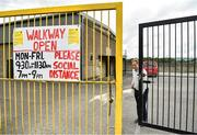 8 June 2020; Tadhg Donavan, Chairman of Buttevant GAA Club, opens the gates to walkers at Buttevant GAA club in Buttevant, Cork. Following restrictions imposed by the Irish Government and the Health Service Executive in an effort to contain the spread of the Coronavirus (COVID-19) pandemic, all GAA facilities closed on March 25. Following the easing of restrictions, walkways in GAA clubs opened to members of the public for exercising on Monday, June 8, with pitches due to fully open to club members for training on June 29, and club matches provisionally due to start on July 31 with intercounty matches due to to take place no sooner that October 17. Photo by Eóin Noonan/Sportsfile