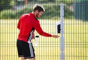 8 June 2020; Colm Horgan sanitises prior to a Derry City training session at Aileach FC in Burnfoot, Donegal. Following approval from the Football Association of Ireland and the Irish Government, the four European qualified SSE Airtricity League teams resumed collective training. On March 12, the FAI announced the cessation of all football under their jurisdiction upon directives from the Irish Government, the Department of Health and UEFA, due to the outbreak of the Coronavirus (COVID-19) pandemic. Photo by Stephen McCarthy/Sportsfile