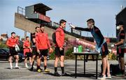 8 June 2020; Paddy Kirk has his temperature taken by Aaron Fitzsimons, Equipment Manager, as his team-mates wait in line, ahead of a Bohemian FC training session at Dalymount Park in Dublin. Following approval from the Football Association of Ireland and the Irish Government, the four European qualified SSE Airtricity League teams resumed collective training. On March 12, the FAI announced the cessation of all football under their jurisdiction upon directives from the Irish Government, the Department of Health and UEFA, due to the outbreak of the Coronavirus (COVID-19) pandemic. Photo by Sam Barnes/Sportsfile