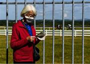 8 June 2020; Racegoer Josephine Gaynor, from Athgoe, South Dublin, studies the form ahead of the Clinton Higgins Chartered Accountants Handicap (DIV II) at Naas Races in Kildare. Horse racing has been allowed to resume on June 8 under the Irish Government's Roadmap for Reopening of Society and Business following strict protocols of social distancing and hand sanitisation among others allowing it to return in a phased manner, having been suspended from March 25 due to the Irish Government's efforts to contain the spread of the Coronavirus (COVID-19) pandemic. Photo by Harry Murphy/Sportsfile