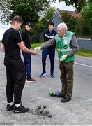 8 June 2020; Willie Murphy, Treasurer of the North Cork Region, and uncle of former Cork ladies footballer Juliet Murphy, supplies competitior Shane Dennehy of Bweeng with hand sanitisier before his match against Donncha Spillane of Ballinagree in the North Cork Boys U16 Road Bowling Championships at Kilcorney, Cork. Road Bowling in the Republic of Ireland has been allowed to resume from June 8 under the Irish Government's Roadmap for Reopening of Society and Business following strict protocols of social distancing and hand sanitisation among other measures allowing it to return in a phased manner. Photo by Piaras Ó Mídheach/Sportsfile