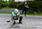 8 June 2020; Willie Murphy, Treasurer of the North Cork Region, and uncle of former Cork ladies footballer Juliet Murphy, wipes the bowls with sanitising wipes before as Shane Dennehy of Bweeng, behind, warms up before his match against Donncha Spillane of Ballinagree in the North Cork Boys U16 Road Bowling Championships at Kilcorney, Cork. Road Bowling in the Republic of Ireland has been allowed to resume from June 8 under the Irish Government's Roadmap for Reopening of Society and Business following strict protocols of social distancing and hand sanitisation among other measures allowing it to return in a phased manner. Photo by Piaras Ó Mídheach/Sportsfile