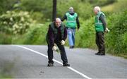 8 June 2020; Terence Sexton, cousin of famous road bowler Séamus Sexton of Nadd, and Road Shower to his son Patrick Sexton, places down a guide marker for his next shot during his match against Alan McMahon of Ballinagree in the North Cork Boys U16 Road Bowling Championships at Kilcorney, Cork. Road Bowling in the Republic of Ireland has been allowed to resume from June 8 under the Irish Government's Roadmap for Reopening of Society and Business following strict protocols of social distancing and hand sanitisation among other measures allowing it to return in a phased manner. Photo by Piaras Ó Mídheach/Sportsfile