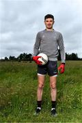 10 June 2020; David Hyland poses for a portrait before a training session with his Athy and Kildare team-mates Kevin Feely and Niall Kelly at a community pitch in Athy, Kildare. Following restrictions imposed by the Irish Government and the Health Service Executive in an effort to contain the spread of the Coronavirus (COVID-19) pandemic, all GAA facilities closed on March 25. Pitches are due to fully open to club members for training on June 29, and club matches provisionally due to start on July 31 with intercounty matches due to to take place no sooner that October 17. Photo by Piaras Ó Mídheach/Sportsfile