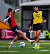 10 June 2020; Jordan Flores, right, in action against Patrick McEleney during a Dundalk training session at Oriel Park in Dundalk, Louth. Following approval from the Football Association of Ireland and the Irish Government, the four European qualified SSE Airtricity League teams resumed collective training. On March 12, the FAI announced the cessation of all football under their jurisdiction upon directives from the Irish Government, the Department of Health and UEFA, due to the outbreak of the Coronavirus (COVID-19) pandemic. Photo by Ben McShane/Sportsfile