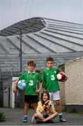 14 June 2020; Havelock Square residents Paddy Allen, age 7, left, Tanya Plant, age 9, with her dog Jelly, and Johnny Murphy, age 8, pose for a portrait near the Aviva Stadium in Dublin. Monday 15 June 2020 was the scheduled date for the opening game in Dublin of UEFA EURO 2020, the Group E opener between Poland and Play-off B Winner. UEFA EURO 2020, to be held in 12 European cities across 12 UEFA countries, was originally scheduled to take place from 12 June to 12 July 2020. On 17 March 2020, UEFA announced that the tournament would be delayed by a year due to the COVID-19 pandemic in Europe, and proposed it take place from 11 June to 11 July 2021. Photo by Stephen McCarthy/Sportsfile