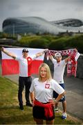 14 June 2020; Poland supporters, from left, Pawel Cherek, from Ongar, Dublin, Magda Boruc and Bart Boruc, both from Naas, Kildare, pose for a portrait near the Aviva Stadium in Dublin. Monday 15 June 2020 was the scheduled date for the opening game in Dublin of UEFA EURO 2020, the Group E opener between Poland and Play-off B Winner. UEFA EURO 2020, to be held in 12 European cities across 12 UEFA countries, was originally scheduled to take place from 12 June to 12 July 2020. On 17 March 2020, UEFA announced that the tournament would be delayed by a year due to the COVID-19 pandemic in Europe, and proposed it take place from 11 June to 11 July 2021. Photo by Stephen McCarthy/Sportsfile