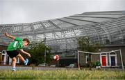 14 June 2020; Havelock Square residents Paddy Allen, age 7, left, takes a shot on his friend Johnny Murphy, age 8, during a kickabout on Havelock Square in the shadow of the Aviva Stadium in Dublin. Monday 15 June 2020 was the scheduled date for the opening game in Dublin of UEFA EURO 2020, the Group E opener between Poland and Play-off B Winner. UEFA EURO 2020, to be held in 12 European cities across 12 UEFA countries, was originally scheduled to take place from 12 June to 12 July 2020. On 17 March 2020, UEFA announced that the tournament would be delayed by a year due to the COVID-19 pandemic in Europe, and proposed it take place from 11 June to 11 July 2021. Photo by Stephen McCarthy/Sportsfile