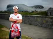 14 June 2020; Poland supporter Bart Boruc, from Naas, Kildare, poses for a portrait near the Aviva Stadium in Dublin. Monday 15 June 2020 was the scheduled date for the opening game in Dublin of UEFA EURO 2020, the Group E opener between Poland and Play-off B Winner. UEFA EURO 2020, to be held in 12 European cities across 12 UEFA countries, was originally scheduled to take place from 12 June to 12 July 2020. On 17 March 2020, UEFA announced that the tournament would be delayed by a year due to the COVID-19 pandemic in Europe, and proposed it take place from 11 June to 11 July 2021. Photo by Stephen McCarthy/Sportsfile