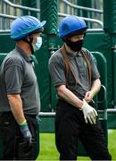 15 June 2020; Stall handlers wearing face masks and gloves prior to the Roscommon Maiden at Roscommon Racecourse in Roscommon. Horse racing has been allowed to resume from June 8 under the Irish Government's Roadmap for Reopening of Society and Business following strict protocols of social distancing and hand sanitisation among others allowing it to return in a phased manner, having been suspended from March 25 due to the Irish Government's efforts to contain the spread of the Coronavirus (COVID-19) pandemic. Photo by Seb Daly/Sportsfile