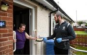 17 June 2020; Sean Owens, member of St. Canice's GAA club in Dungiven, Derry, delivers a hot dinner to Bernie O'Neill, a member of the local community, as GAA clubs nationwide help out their local communities during restrictions imposed by the Irish and British Governments in an effort to contain the spread of the Coronavirus (COVID-19) pandemic. GAA facilities reopened on Monday June 8 for the first time since March 25 with club matches provisionally due to start on July 31 and intercounty matches due to to take place no sooner that October 17. Photo by Stephen McCarthy/Sportsfile