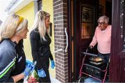 17 June 2020; Grainne O'Neill and daughter Darcy, members of St. Canice's GAA club in Dungiven, Derry, delivering hot dinners to Maureen McGilligan, a member of the local community, as GAA clubs nationwide help out their local communities during restrictions imposed by the Irish and British Governments in an effort to contain the spread of the Coronavirus (COVID-19) pandemic. GAA facilities reopened on Monday June 8 for the first time since March 25 with club matches provisionally due to start on July 31 and intercounty matches due to to take place no sooner that October 17. Photo by Stephen McCarthy/Sportsfile