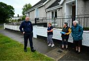 17 June 2020; Professional boxer and member of An Garda Síochána Niall Kennedy speaks with residents of Crinion Park during a PPE drop-off while on duty out of Wicklow Garda Station. Photo by Stephen McCarthy/Sportsfile